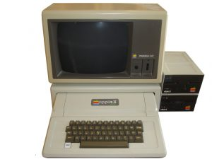 Photo of an Apple II+ with Apple monitor and two external disk drives